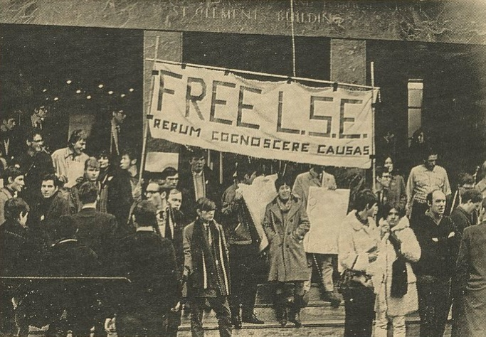 "Students holding a banner reading ""free LSE"" with the motto outside St Clement's Building."