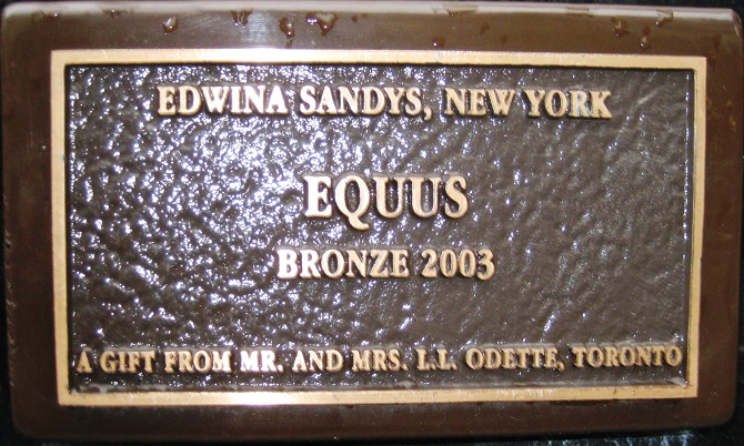 "A close up of the plaque on Equus, reading ""Edwina Sandys New York. Equus bronze 2003. A gift from Mr and Mrs L L Odette, Toronto."" Credit: Sue Donnelly"