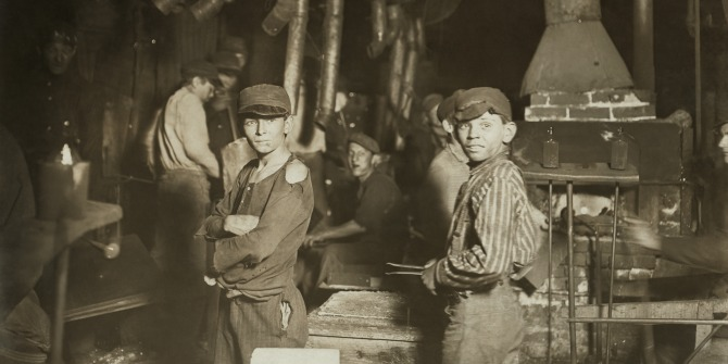 Children working in an Indiana glass factory in 1908. Photo Credit:  Lewis Wickes Hine. Restored by Michel Vuijlsteke. Wikimedia Commons.