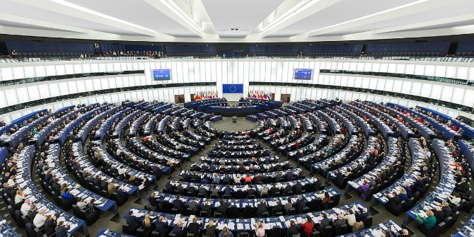 Image Credit: Diliff, The Parliament's hemicycle (debating chamber) during a plenary session in Strasbourg. Wikipedia. CC-BY-SA 3.0.