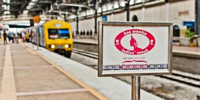Image Credit: Koc Wanita street sign in Malay, My Train Pix. Wikipedia. CC-BY-SA 2.0.