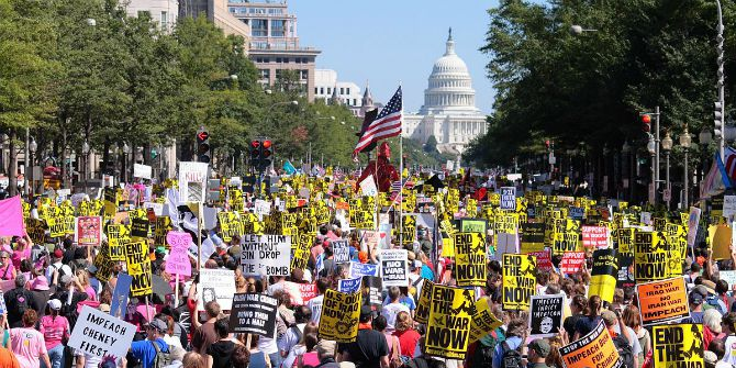 Image Credit: Ragesoss, Protesters march down Pennsylvania Avenue toward the Capitol. Wikipedia. CC-BY-SA 3.0.