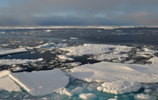 Blue sky begins to break through the clouds over Arctic Ocean ice Sept. 9, 2009.