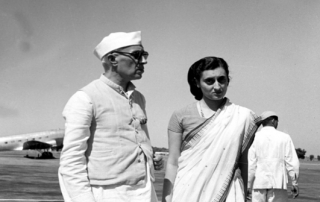 Studio/Oct.49, A22a(ii) Mrs. Indira Gandhi with the Hon'ble Pandit Jawaharlal Nehru Prime Minister of India photographed at Palam Aerodrome on October 3, 1949, before her departure for London. She is expected to join the Prime Minister in the U.S.A. during the latter's forthcoming visit to that country.