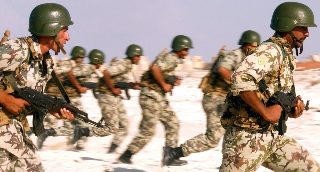 Egyptian Army Soldiers practice their beach assault techniques at El Omayed, Egypt, 2011. Public Domain.