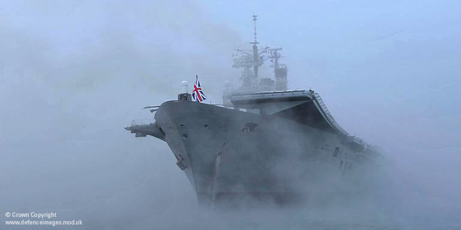 HMS Ark Royal Emerges from the Mist to Dock in Portsmouth for the Final Time