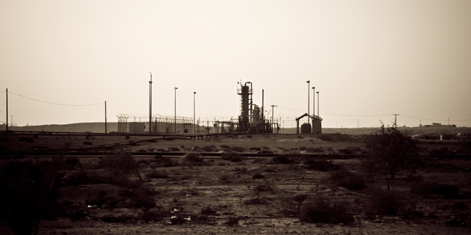 Oil drilling in the Bahrain desert. Copyright Philippe Leroyer