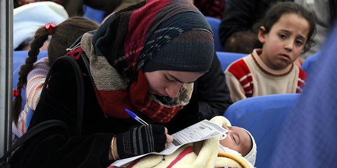A refugee filling an application at the UNHCR registration center in Tripoli, Lebanon. Photo: Mohamed Azakir / World Bank