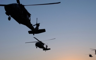 U.S. Army UH-60 Black Hawk helicopters prepare to pick up and transport Soldiers for an air assault mission near Samarra, Iraq, March 3, 2007. (U.S. Air Force photo by Tech. Sgt. Molly Dzitko) (Released)