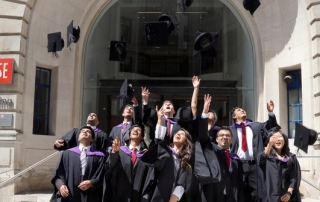 LSE graduates throw their mortar boards in the air to celebrate their graduation on the 17th July 2014