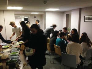 Students loading their wraps with quality vegetarian ingredients