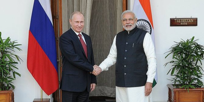Narendra_Modi_and_Vladimir_Putin_shake_hands_in_New_Delhi_in_2014