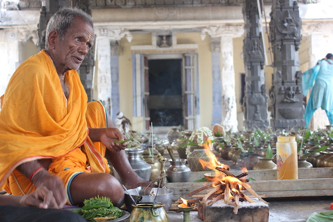 2 - A Tamil Jain priest preparing for a puja on Mahavir Jayanthi