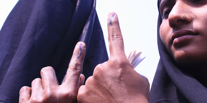 Nagaon: 23rd April 2009 :Two muslim women voters showing their marks on finger after voting at Samaguri in Nagaon district of Asam on thursday. Pix : Diganta Talukdar