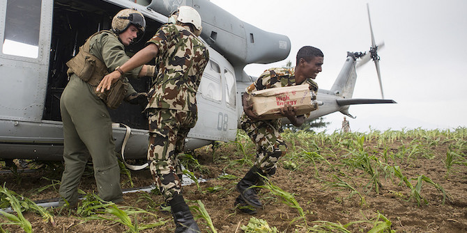 Nepali soldiers unload aid and relief supplies delivered by a U.S. Marine Corps. Credit: Sgt. Jeffrey D. Anderson CC BY-NC-ND 2.0