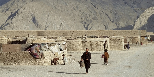 Afghan refugees in Quetta, Pakistan, who live outside of the formal system of refugee camps. The hills in the background are Jurassic limestone.