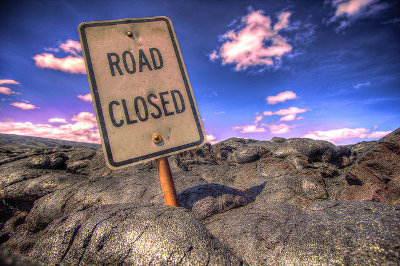 Road closed by lava in Hawai'i Credit: Casey Bisson (Flickr, CC-BY-NC-SA-2.0)