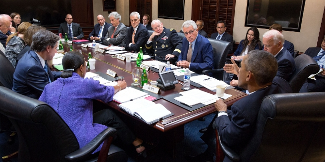 President Barack Obama and Vice President Joe Biden meet with members of the National Security Council in the Situation Room of the White House, Sept. 10, 2014. (Official White House Photo by Pete Souza)