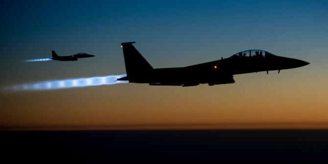 Two U.S. Air Force F-15E Strike Eagle aircraft fly over northern Iraq Sept. 23, 2014, after conducting airstrikes in Syria. (DoD photo by Senior Airman Matthew Bruch, U.S. Air Force/Released)
