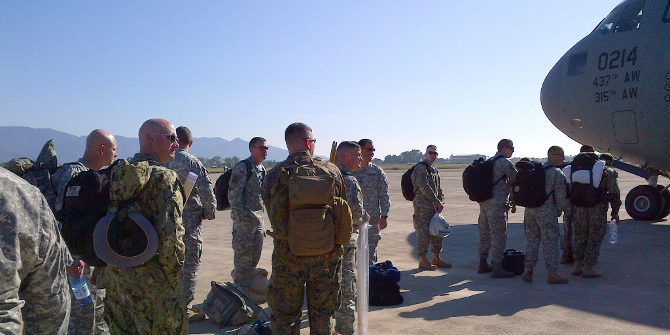 U.S. Army Africa, Joint Public Affairs Support Element, Joint Services Communications Element and 101st Airborne personnel supported by the 724th Air Mobility Squadron prepare to move people and equipment in support of Operation United Assistance near Pisa, Italy. The U.S. military is in support of USAID operations in response to the Ebola outbreak in West Africa. (U.S. Army Africa photos by Lt. Col. Michael Indovina)