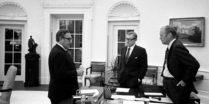 President Ford meets in the Oval Office with Secretary of State Henry A. Kissinger and Vice President Nelson A. Rockefeller to discuss the American evacuation of Saigon, Oval Office, White House, Washington DC.. 1975 Credit: Wikimedia Commons