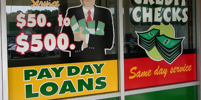 Americans with payday loans spent or saved their tax rebates, rather than using it to pay off debt.