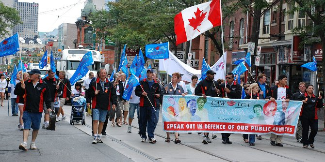 """Labour Day Parade Toronto September 2011"" by CAW Media - Labour Day Toronto 2011 139Uploaded by Skeezix1000. Licensed under CC BY 2.0 via Wikimedia Commons"
