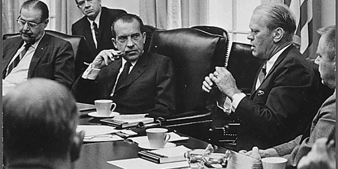 Official White House photograph of Minority Leader Gerald Ford in meeting with Richard Nixon. Obtained Ford Presidential Library.
