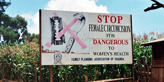 Road sign in Uganda campaigning to end female genital mutilation